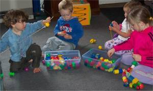 Preschool Activities – Fine Motor – Children Lacing Beads