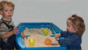 Sensory activities – for toddlers, toddlers playing in sand table